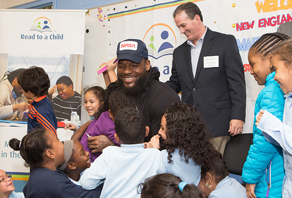 Patriot's Tight End and children's book author Martellus Bennett reads to children in Lunchtime Reading Program.