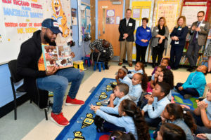 "ROXBURY, MA - NOVEMBER 15: Patriots Tight End and Children's Book Author Martellus Bennett visits Read to a Child's Lunchtime Reading Program at Boston Public Schools' Tobin K-8 and reads his new book ""Hey A.J., It's Saturday!"" to first and second graders on November 15, 2016 in Roxbury, Massachusetts. (Photo by Paul Marotta/Getty Images)"